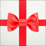 Wrapped vintage gift with red bow Stock Photos