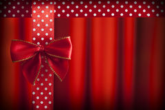 Red bow and ribbon on red background Royalty Free Stock Photos