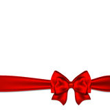 Red bow with ribbon. On a white background Royalty Free Stock Photography