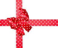Red bow and ribbon with white polka dots made from silk. Isolated royalty free stock images