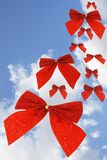 Red bow ribbons in the sky Royalty Free Stock Photography