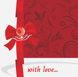 Red bow with rose and strasses. Background Royalty Free Stock Image