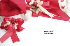 Red bow and Santa Claus hat. Royalty Free Stock Photo