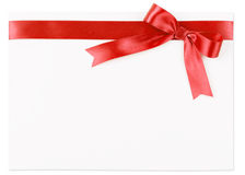 Red bow on a satin ribbon Stock Photos