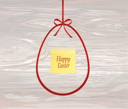 Red bow in the shape of the Easter egg. Greeting card or invitat. Ion for a holiday.  Yellow sheet of paper for notes. Sticker.  Empty place for text or Stock Photography