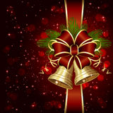 Red bow and shiny bells Royalty Free Stock Photos
