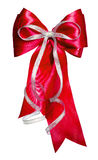 Red bow with silver ribbon made from silk Royalty Free Stock Images