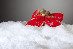 Red Bow in snow Royalty Free Stock Images