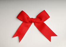 Red bow on the table. With gradient background Stock Photo