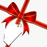 Red bow with tag Royalty Free Stock Images