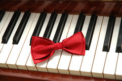 Red bow-tie. On piano keys Stock Photography