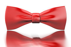 Red bow-tie. Red shiny bow-tie isoladed on mirror surface Stock Photos