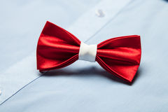 Red bow tie on a blue shirt Stock Photography