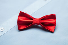 Red bow tie on a blue shirt Royalty Free Stock Image