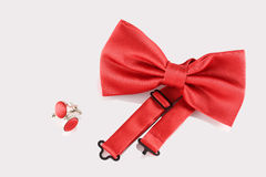 Red bow tie  with cuff links Royalty Free Stock Photos