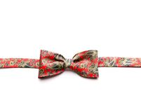 Red bow-tie with flowers Royalty Free Stock Photo
