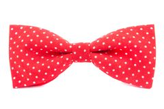 Red bow tie with polka dots isolated Stock Images