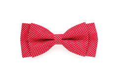 Red bow tie with white polka dots isolated on white Royalty Free Stock Images