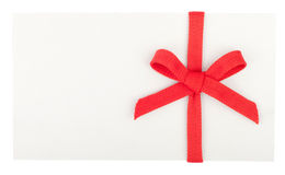 Red bow on a white box or envelope Stock Images