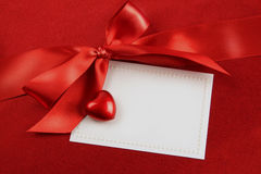 Red bow and white card for gift Royalty Free Stock Photo