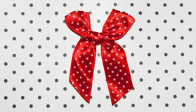 Red bow. White circle on a white background in a black circle Stock Photos