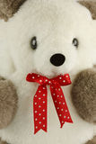 Red bow with white dots. Closeup red bow and white dots with teddy bear Stock Images