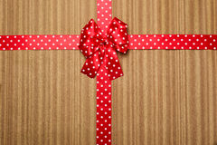 Red bow on wood background Royalty Free Stock Photos