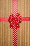 Red bow on wood background Stock Images