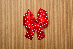 Red bow on wood background Stock Image
