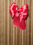 Red bow on wooden background Stock Images