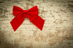 Red bow on a wooden background Stock Image