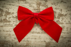 Red bow on a wooden background Royalty Free Stock Images