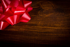 Red bow on wooden brown planks Royalty Free Stock Images