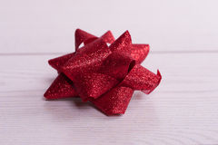 Red Bow on a Wooden Royalty Free Stock Photos