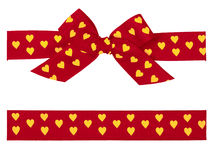 Red bow with yellow hearts and ribbon Royalty Free Stock Photos