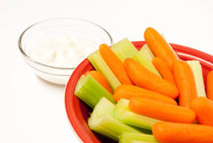 Red Bowl of Baby Carrots and Celery Royalty Free Stock Photo