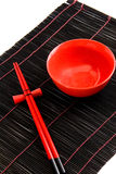 Red bowl and chopsticks Royalty Free Stock Photography