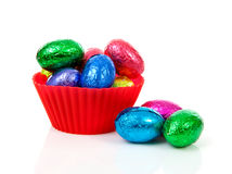 Red bowl with colorful easter eggs Stock Photography