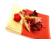 Red bowl with dried flowers as Christmas ornaments Stock Photos