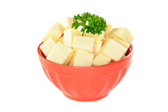 Red bowl with mozzarella cheese and parsley, white background. Red bowl with mozzarella cheese and parsley, on white background Royalty Free Stock Image