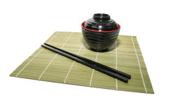 Red bowl of rice with wooden chopsticks and a wood place mat Stock Photography