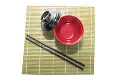 Red bowl of rice with wooden chopsticks and a wood place mat Stock Images