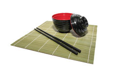 Red bowl of rice with wooden chopsticks and a wood place mat Stock Photos