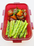 Red bowl of sauteed carrot, asparagus and radish Stock Image