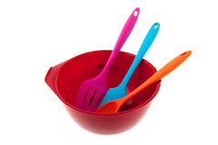 Red bowl with spoons Royalty Free Stock Image