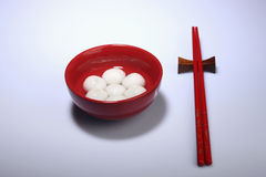 Red bowl of tang yuan with chopsticks Stock Photography