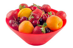 Red bowl, vase filled with fruits Stock Photography