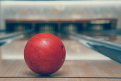 Red bowling ball on the track in the bowling center Stock Photo