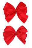 Red bows. Two red bows isolated over white with clipping path Royalty Free Stock Photos
