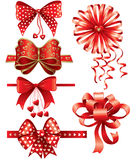 Red bows with hearts Royalty Free Stock Image